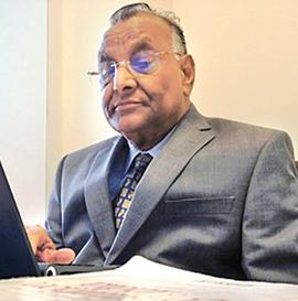 Dr Justice G C Bharuka
