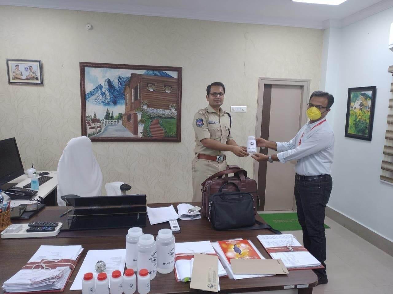 Dr. R. Vijay handing over the hand sanitizer bottles made at ARCI to Shri Sunpreet Singh, DCP, Rachakonda Commissionerate