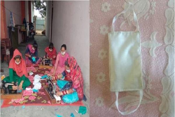 Women in Hoshiarpur, Punjab prepare homemade masks for villagers to fight COVID-19